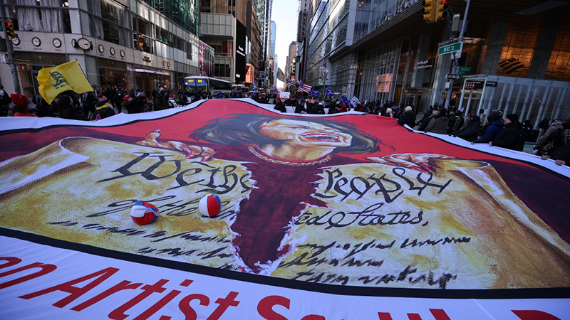 Image for Trump supporters clash with ANTIFA in Manhattan after unfurling a huge flag of Pelosi as a demon outside Trump Tower