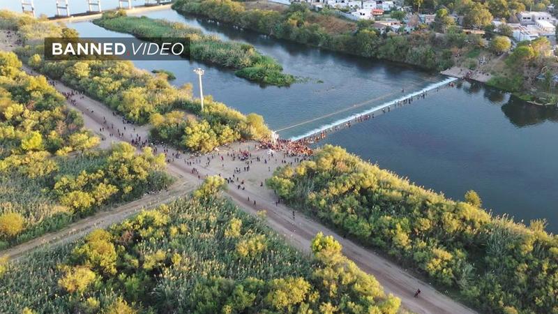 Image for Exclusive: Drone Captures Second, Huge Haitian Caravan Smashing Across Texas Border